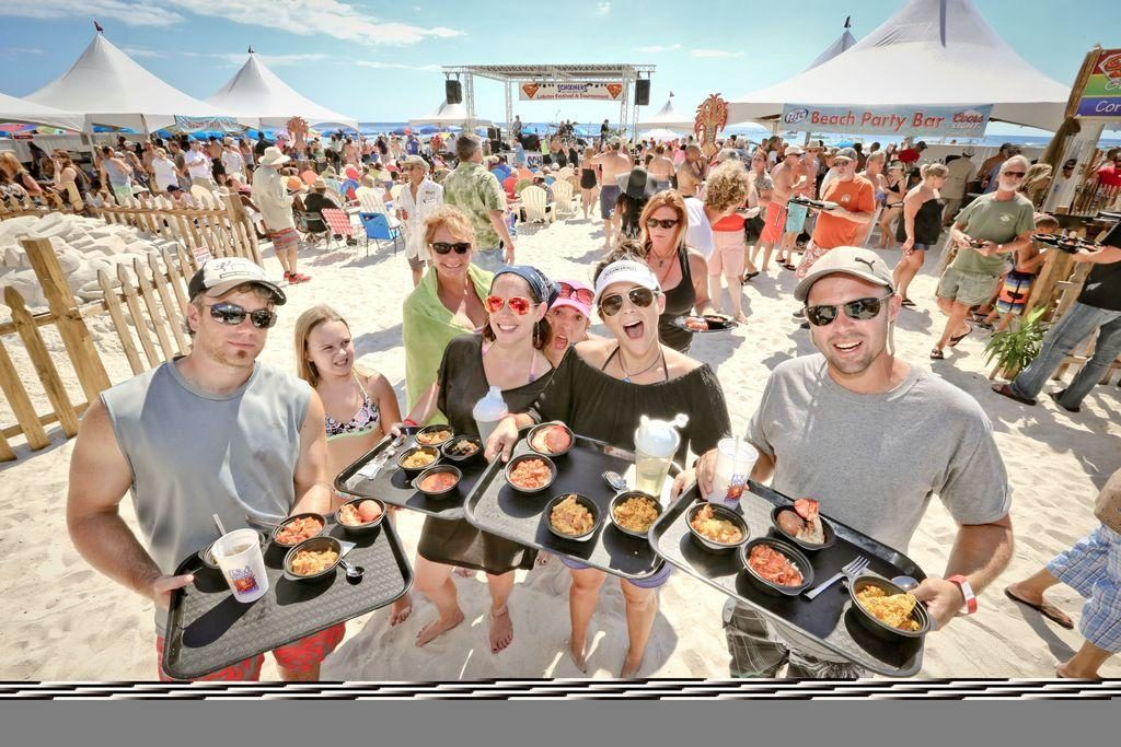Schooners Lobster Festival 2019 in Panama City Beach Florida - visitors enjoying lobster dishes on the beach